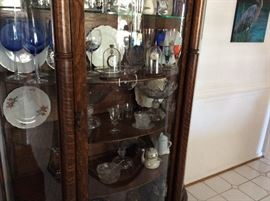 Beautiful antique China cabinet with bowed front and side glasses