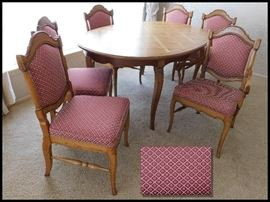 "Dining room table with six beautifully upholstered chairs 66"" x 43"" without leafs. This set has three one foot leafs.  Purchased at Gabberts."