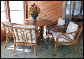 Four Rattan chairs with 4 foot diameter table with two 16 inch leafs