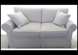 "Two cushion  loveseat.  There are two of these. They measure 60"" x 40"" x 34"""