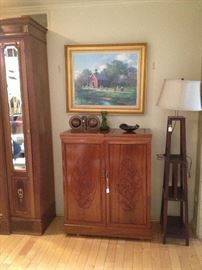 Beautiful fold out bar with fancy carving. Unknown artist large sofa painting.
