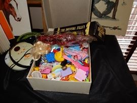 Smalls a box of toys meant for dolls