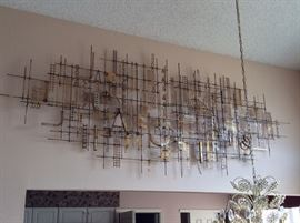 Timeless abstract art piece, originally hung in a local brokerage firm. Around 12'x4' in size.  Comes apart in two sections.