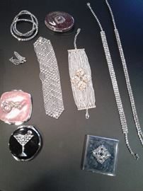 Collection of small sparkly things including a Sergio Gutierrez liquid metal bracelet