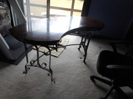 Kidney shaped desk / table on wrought  iron base. Made by Lane