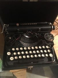 We love this vintage travel Underwood typewriter with carrying case.  In excellent condition.  This would be a perfect addition to your vintage home decor!