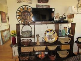 Bookshelf, Roku tv, lamp, baskets, metal wall décor, wall decor