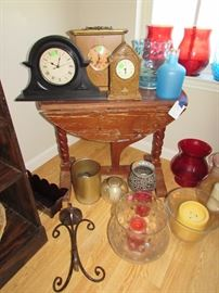 Drop leaf Pine table, clocks, candle jars, bottles, candleholders