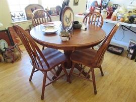 Pedestal table and four chairs.  More chickens and roosters