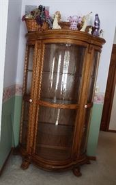Oak claw foot, curved glass china cabinet