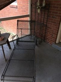 Iron chaise lounge. Also table and chairs, shelf, other items.