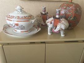 Motahedah soup tureen, elephant candlesticks and asian jar.