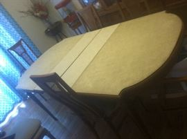 SAME TABLE WITH THE COVER ON IT. ALSO HAS 6 CHAIRS 2 ARM CHAIRS AND 4 REGULAR CHAIRS