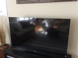 One of several flat screen TVs