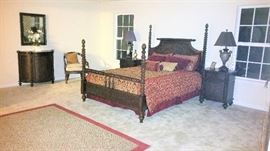 This master bedroom is very unusual.  4 poster barley twist headboard and footboard with matching pair of nightstands, commode cabinet with mirror, occasional chair, double dresser and round mirror, chaise and 7 ft tall floor mirror