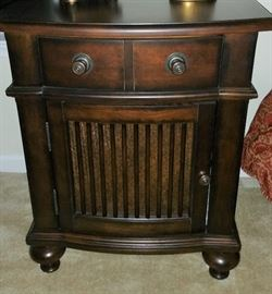 One of pair of matching nightstands