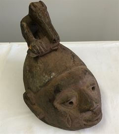 "Suku tribal helmet mask, with an animal surmount. This is an initiation mask, marking the transition from boyhood to manhood, from the Congo. It dates to the mid 20th century. See pictures for condition issue. Measures 12"" in length"