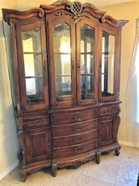 Ornate lighted Carved wooden Curio China Cabinet . No reserve It must sell  Original price sticker  $1399