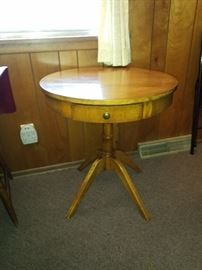 Antique round table with a drawer