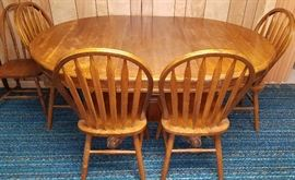 Round oak pedestal table, leaf & four slat back chairs