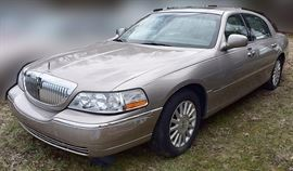 At 8PM: 2003 Lincoln Town Car Luxury Sedan Estate Auto | Signature Edition; Silver-Beige Metallic Exterior with Beige Leather Interior; Power Seats, Locks, Windows, Mirrors; 2-Position Memory Driver's Seat; Heated Front Seats; Dual Climate Controls; Power Moonroof; AM/FM Stereo with CD and Cassette, and more. VIN: 1LNHM82WX3Y642850