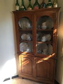 corner cabinet, wine bottles, 2 china patterns