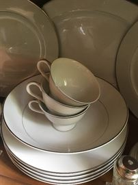 lovely china pattern white with a silver band.