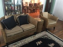 Great wicker furniture and Oriental rug