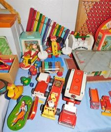Lots of 1950s wooden Fisher Price toys