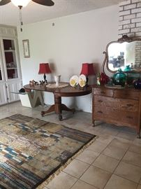 Beautiful antique pieces and large rug.