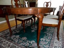 """Thomasville dining table with two 20"""" leaves and full set of pads.  Table width is 44"""", length when closed is 68"""", extends to 88"""" with one leaf and 108"""" with both leaves.  Comes with 2 arm chairs and 6 side chairs."""