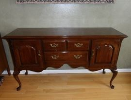 """Thomasville sideboard with two drawers, two  doors with shelves behind, brass hardware and tall cabriole legs.  60"""" x 18"""" x 34""""  tall."""