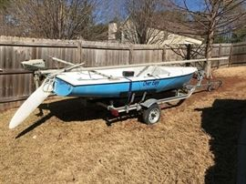 """Sailboat for Sale - 1976 Chrysler CBC43327M76L Mutineer 15' sailboat on brand new never launched aluminum MagicTilt trailer w/LED lights. Garage stored. Tube furling jib and bolt rope mainsail on a 22' mast. Centerboard housing recently rebuilt and sealed. Homebuilt cover for cubby to prevent """"swamping"""". Brand new Mutineer lineset from Salty Dog Marine included. Was fully restored in 2003 and only sailed a few times after that so it needs a good wash. Has a Suzuki DT2 2HP 2 cycle outboard motor. One of the original bailers is broken, otherwise ready to sail. Also has small gash in keel from support roller on original trailer but does not leak. Includes replacement parts for motor, boat cover, sail bag. Boat info @ mutineer15.org. Asking $2,500. Located SW of Atlanta."""