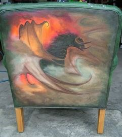Back of Lord of the Rings chair signed by Artist bottom right