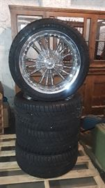 4 Goodyear Fortera 305/40R22's SL Edition on GREED Lust Rims.  Tires still have nipples on them