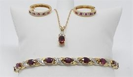 Beautiful ruby and diamonds set in 14k gold. Bracelet, necklace and hoop earrings.