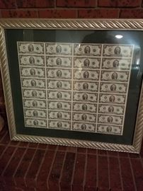Framed sheet of two dollar bills. There are two of these.