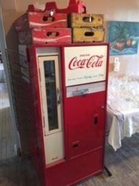 1960's Coke vending machine has original paint, side rack & works