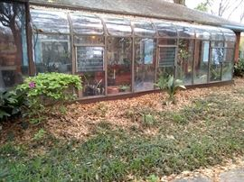 Awesome greenhouse shown here attached to the home