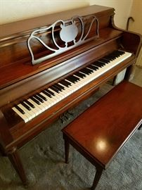piano and matching bench. excellent condition, beautiful walnut. good keys.