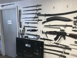 Dozens of edged weapons including rare bayonets and knives