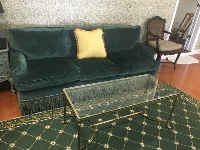 Green velvet sofa, gold table & rug