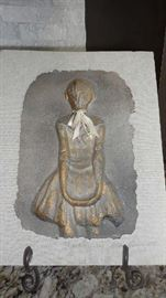 "Living Room:  This paper plaque represents Edgar Degas' ""Little Dancer.""  It is signed by the artist."