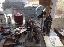 Interesting pieces...vintage removing projector, stir up, cast iron iron, rug beater, roller skates, set of chips, scales