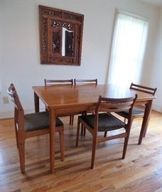 "Mid Century Modern ""Made in Denmark"" teak dining table with 5 chairs."