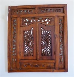 Unusually carved mahogany mirror with shutter doors