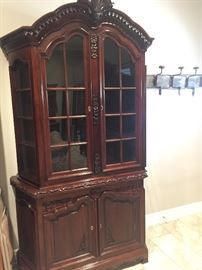 one of four smaller lighted china cabinets