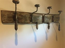 coat rack made of four antique hand turned drills--COOL!