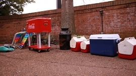 Assorted coolers, CocaCola cooler on wheels