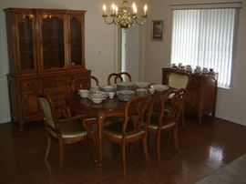 "11 piece dining set. China cabinet is two piece. Table has a 12"" leaf."
